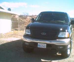 Image of a 2003 Ford F150 4x4 crewcab XLT